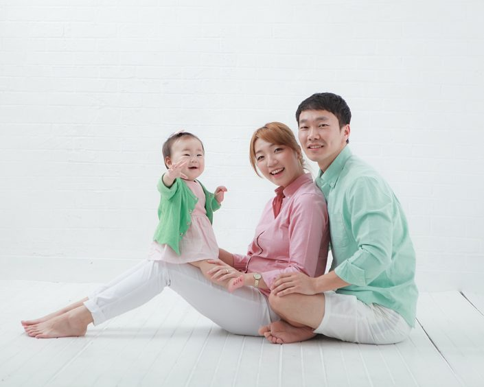 baby smiling with parents