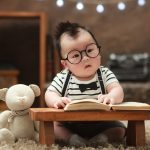 baby with eye glass