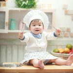 baby cook with spoons